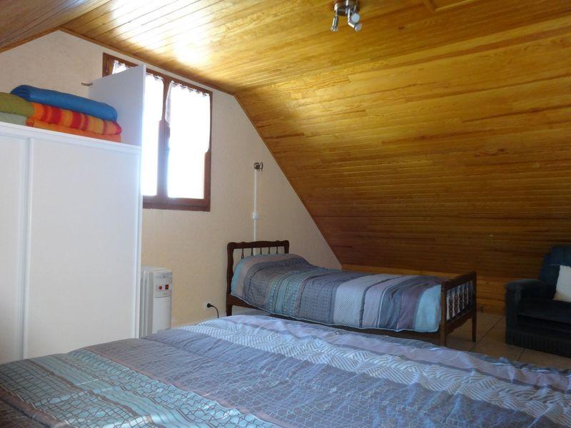 Chambre haut Meublé Mme CESMAT D Location Ancelle - © OTi RR
