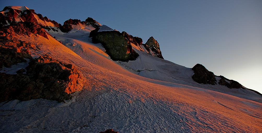 Coucher de soleil sur le massif de la Meije depuis le rocher de l'Aigle - La Grave