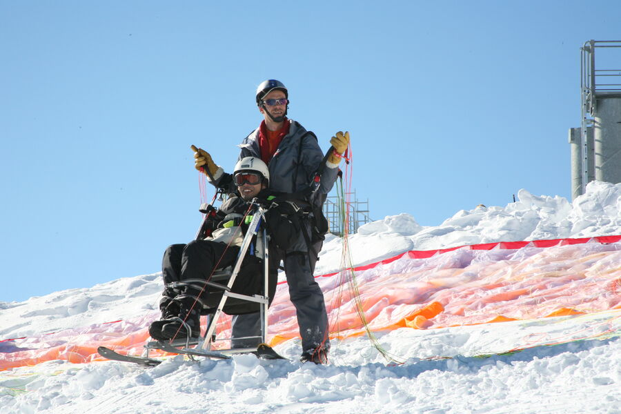 Maiden paragliding flight for disabled people